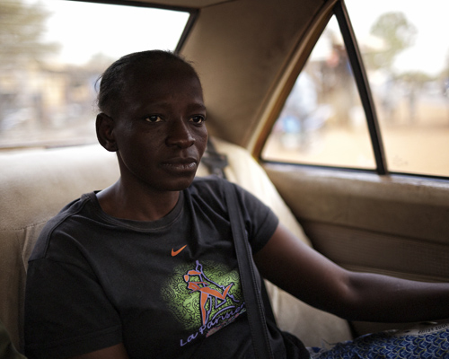 Cécile in Aruna's taxi.