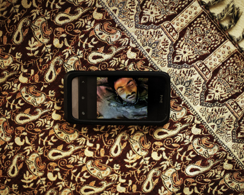 A dead soldier on a video taken by a member of the Liwa Diraa Al Ahraar brigade (part of the Islamic Front).