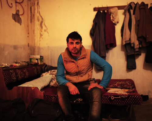A Kurdish refugee, in the room he shares with other men. Kiziltepe, Turkey.