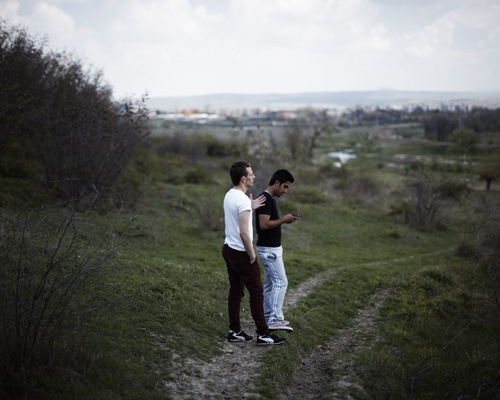 Harmanli, Bulgaria. Two young Syrian talk about one of their project to raise awarness about Syrian refugee : reach ONU headquarter in Geneva by bike from their refugee camp in Harmanli. Abo Hajar life's summary. - Syria(s).